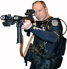 Anders_Behring_Breivik_in_diving_suit_with_gun_(self_portrait)