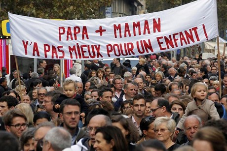"""A mother and father.  There's nothing better for a child!""  proclaims a banner at   a rally to protest same sex marriage in France last year"