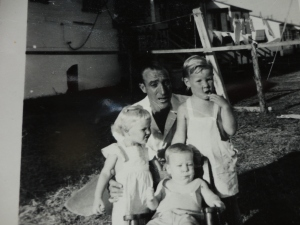 Dad with Barbara, Ed and me in 1949
